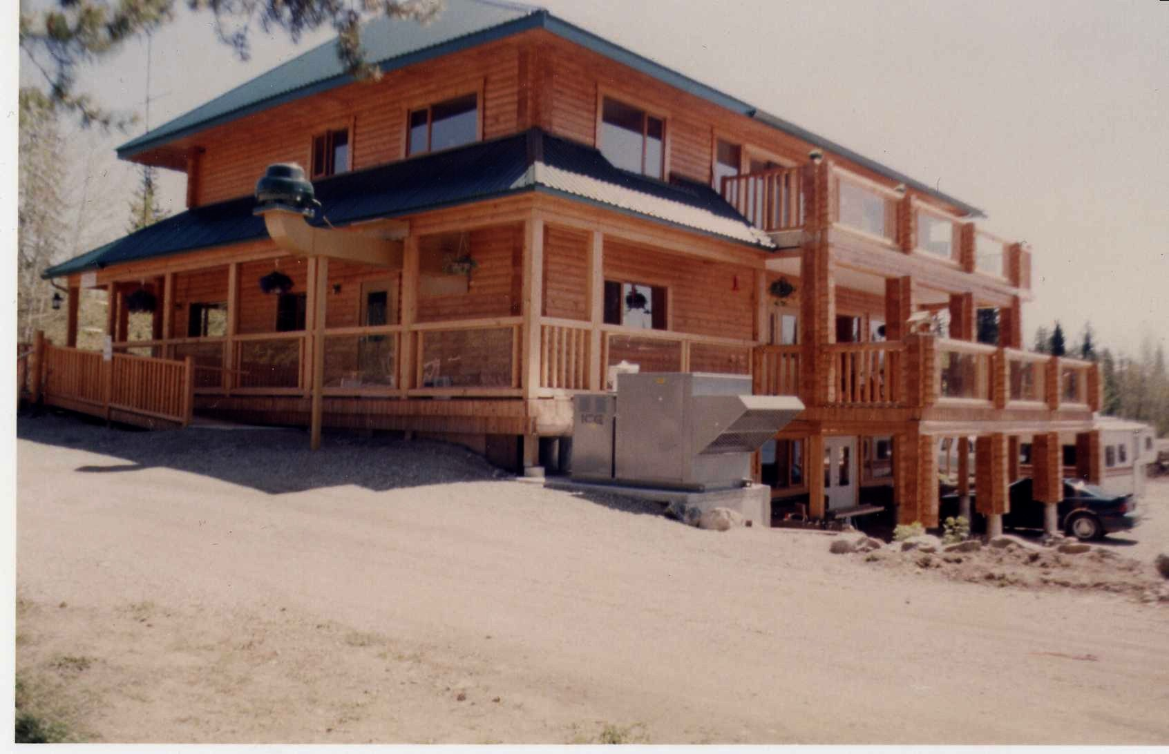 Two storey with wrap-around porches & open decks