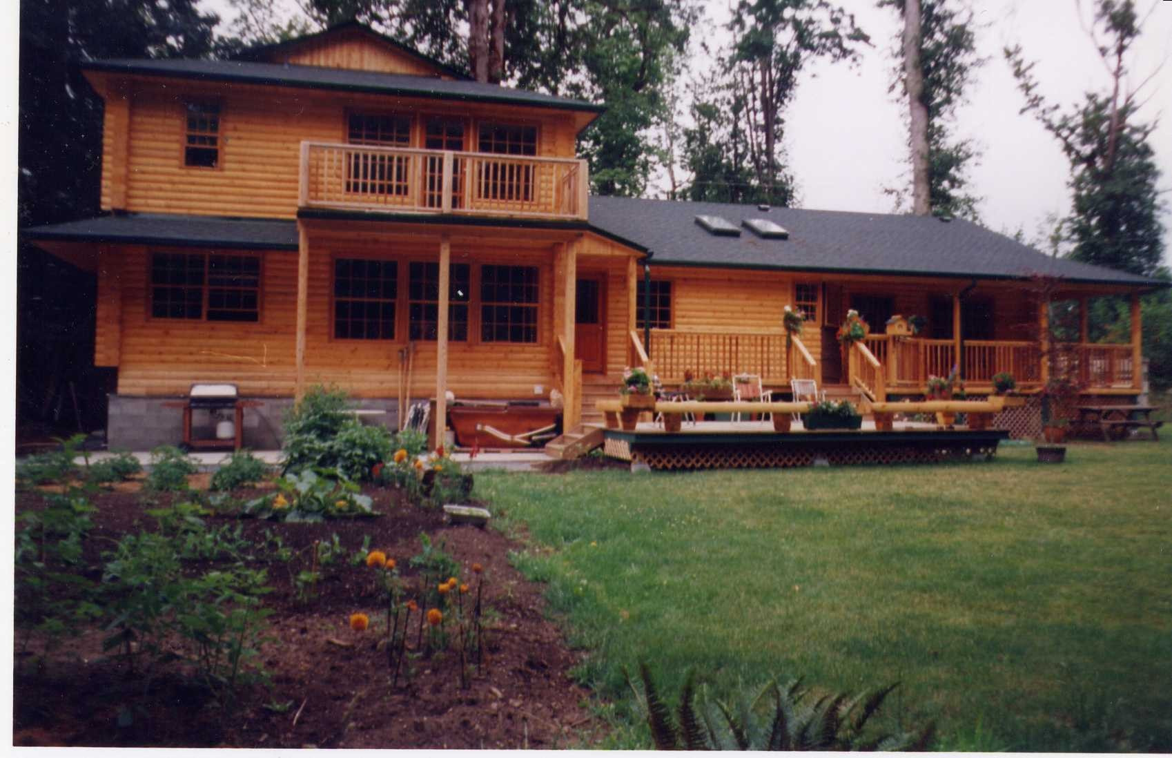 Two storey with open deck & covered porches