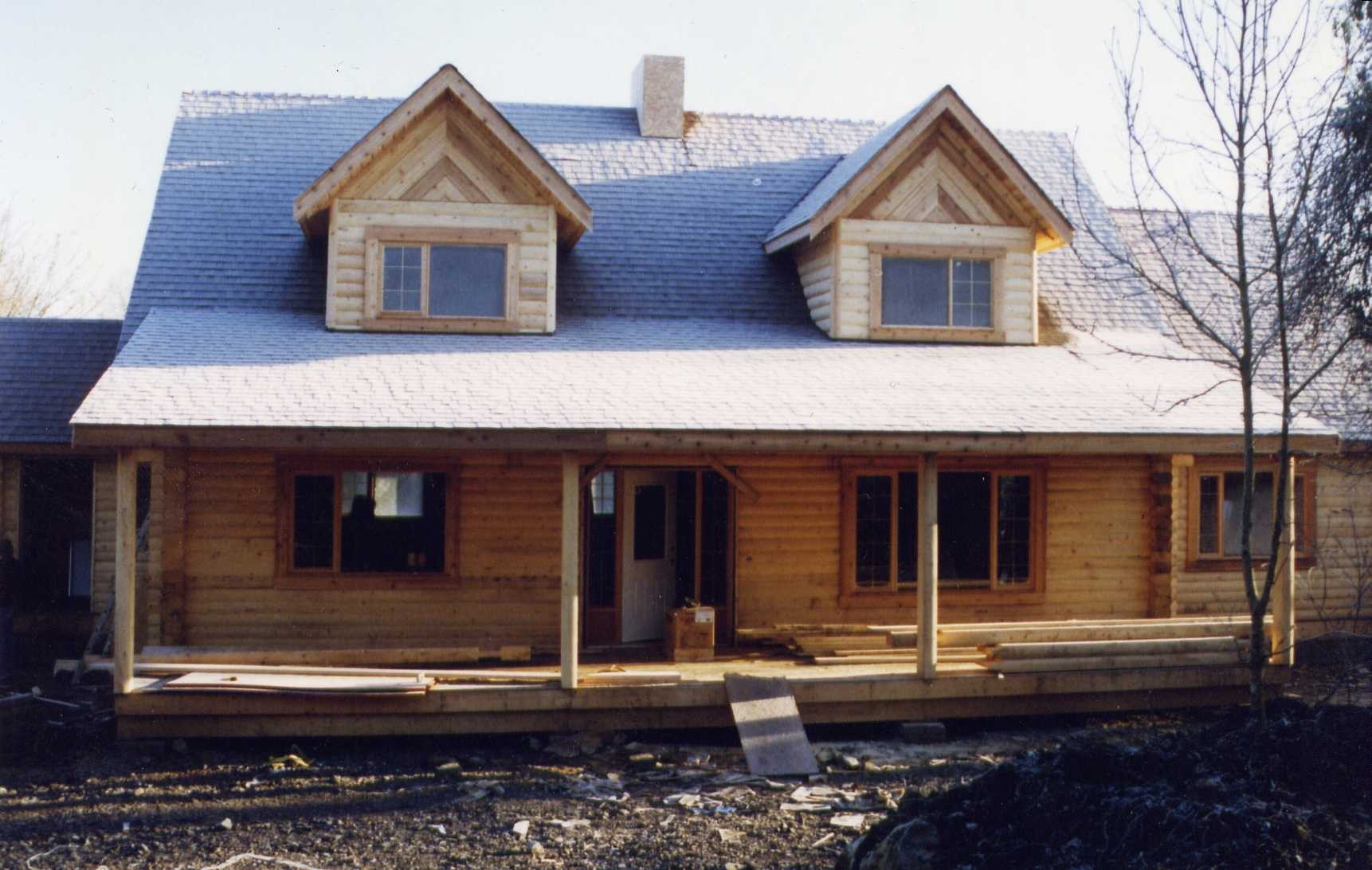 Slideshow of machined log home construction northern log for Windows for log homes